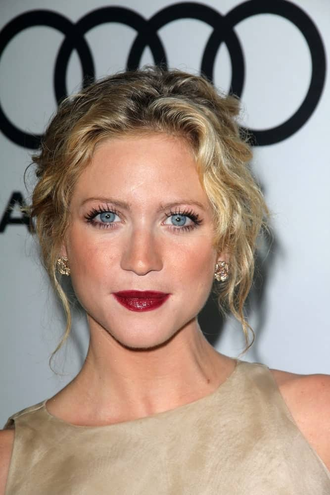 Brittany Snow attended the Audi and Derek Lam Kick Off Emmy Week 2012, Cecconi's, West Hollywood, CA on September 16, 2012. She wore a chraming beige dress with her messy and curly sandy blonde bun hairstyle.