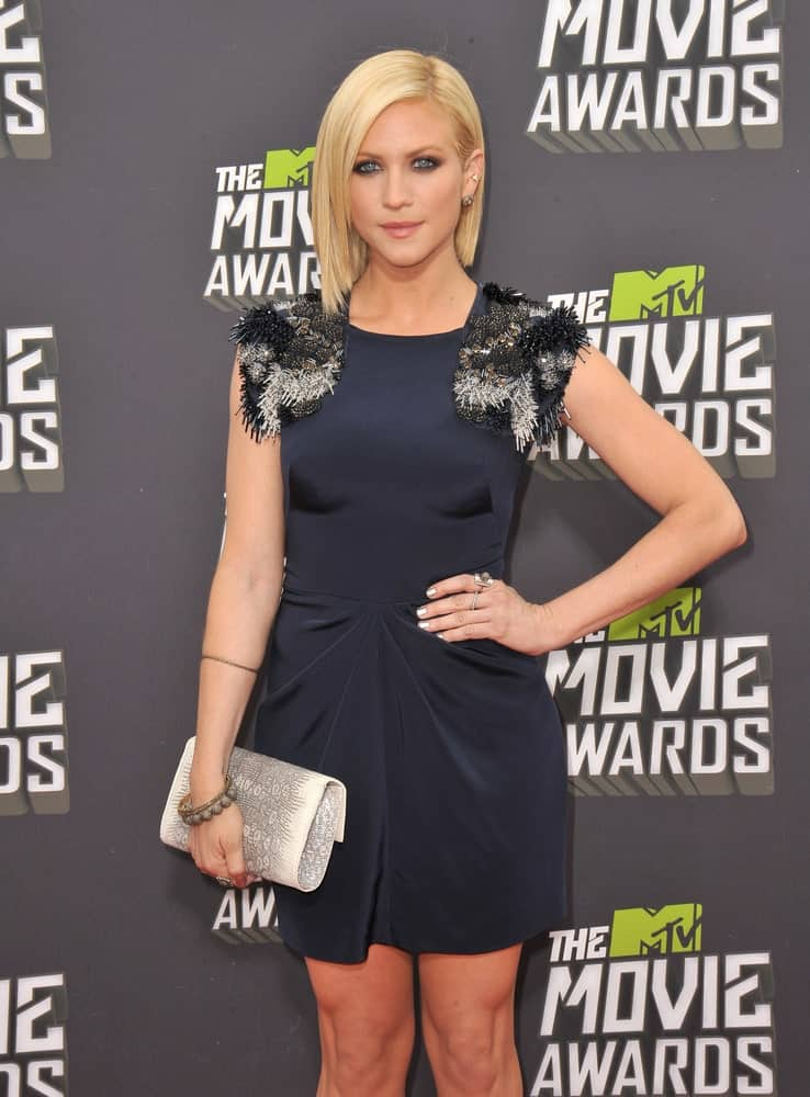 Brittany Snow attended the 2013 MTV Movie Awards at Sony Studios, Culver City on April 14, 2013 in Los Angeles, CA. She wore a sexy black dress with her chin-length straight blonde bob hairstyle.