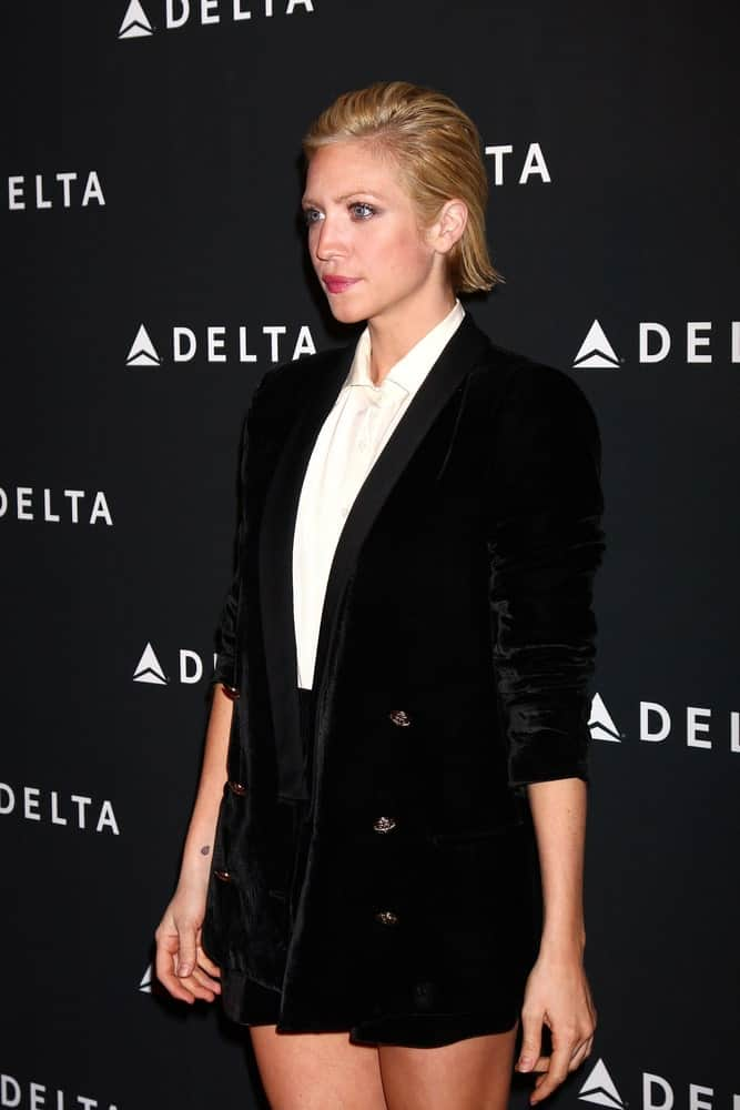 Brittany Snow was at the Celebration of LA's Music Industry reception at the Getty House on February 7, 2013 in Los Angeles, CA. SHe wore a smart casual outfit with her slicked back short sandy blonde hairstyle.