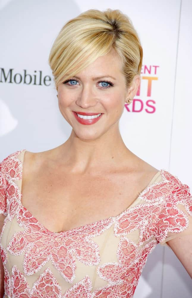 Brittany Snow was at the 2013 Film Independent Spirit Awards held at the Santa Monica Beach in Los Angeles, California on February 23, 2013. She wore a floral pink dress to pair with her sandy blonde bun hairstyle with long side-swept bangs.