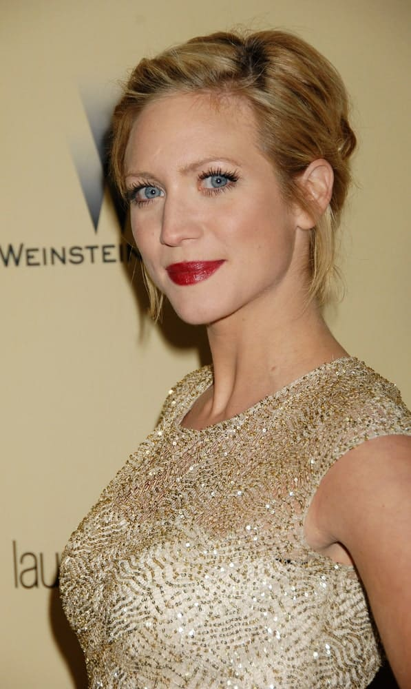 Brittany Snow was at the 2013 Weinstein Company Golden Globes After Party on January 13, 2013 in Beverly Hills, CA. SHe emphasized her red lips with a golden dress and a sandy blonde messy bun hairstyle.