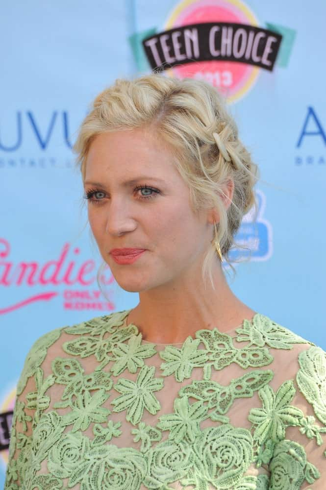Brittany Snow was at the 2013 Teen Choice Awards at the Gibson Amphitheatre, Universal City, Hollywood on August 11, 2013 in Los Angeles, CA. She was seen wearing an embroidered sheer dress to pair with her messy blonde bun hairstyle incorporated with braids.