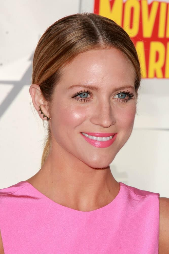 Brittany Snow was at the MTV Movie Awards 2015 at the Nokia Theater on April 11, 2015 in Los Angeles, CA. She was charming in a pink dress that she paired with her slick and highlighted sandy blonde ponytail.