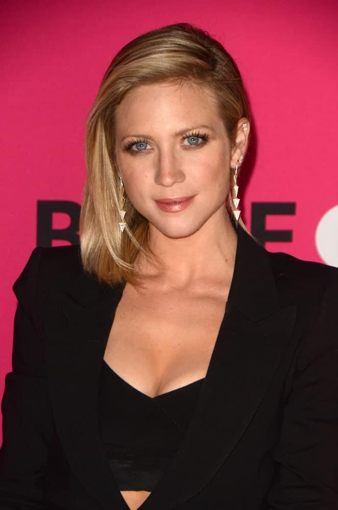 Brittany Snow attended the T-Mobile Un-carrier X Launch Celebration at the Shrine Auditorium on November 10, 2015 in Los Angeles, CA. She wore a fashionable black outfit with her side-swept shoulder-length blonde bob hairstyle.