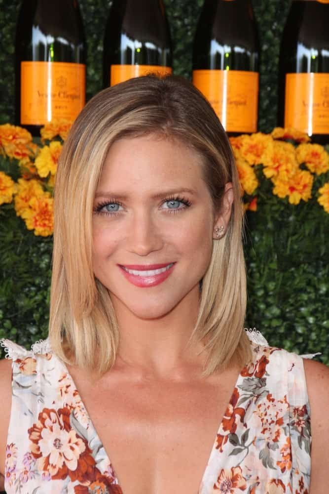 Brittany Snow was at the Sixth-Annual Veuve Clicquot Polo Classic at the Will Rogers State Historic Park on October 17, 2015 in Pacific Palisades, CA. She wore a lovely floral sundress to pair with her shoulder-length layered blonde bob hairstyle with subtle highlights.