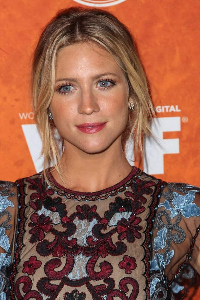 On September 18, 2015, Brittany Snow attended the Variety and Women in Film Annual Pre-Emmy Celebration. She was seen wearing a patterned and colorful dress to pair with her messy blonde bun hairstyle with loose side bangs.