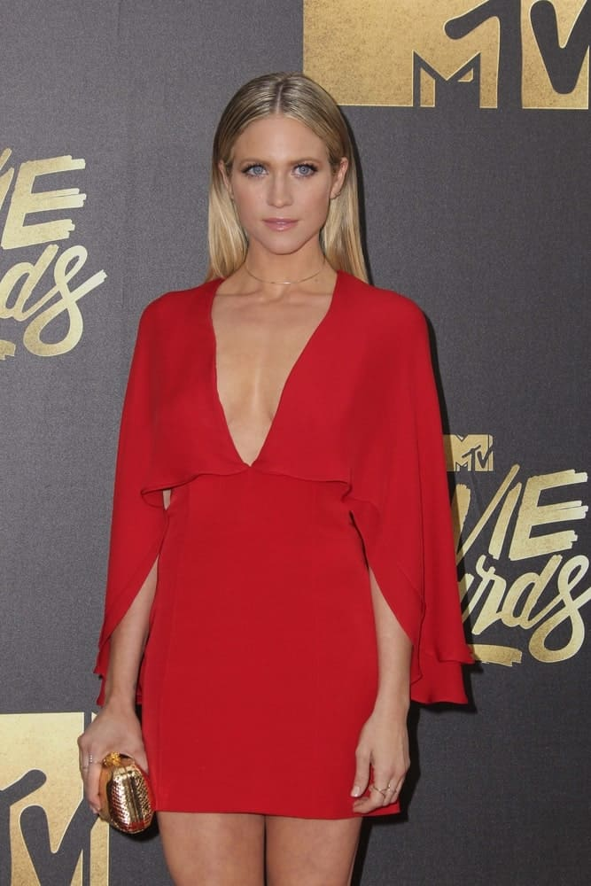 Brittany Snow attended the 2016 MTV Movie Awards at the Warner Brothers Studio on April 9, 2016 in Burbank, CA. She was stunning in a red dress that she paired with along slicked-back sandy blonde hairstyle.