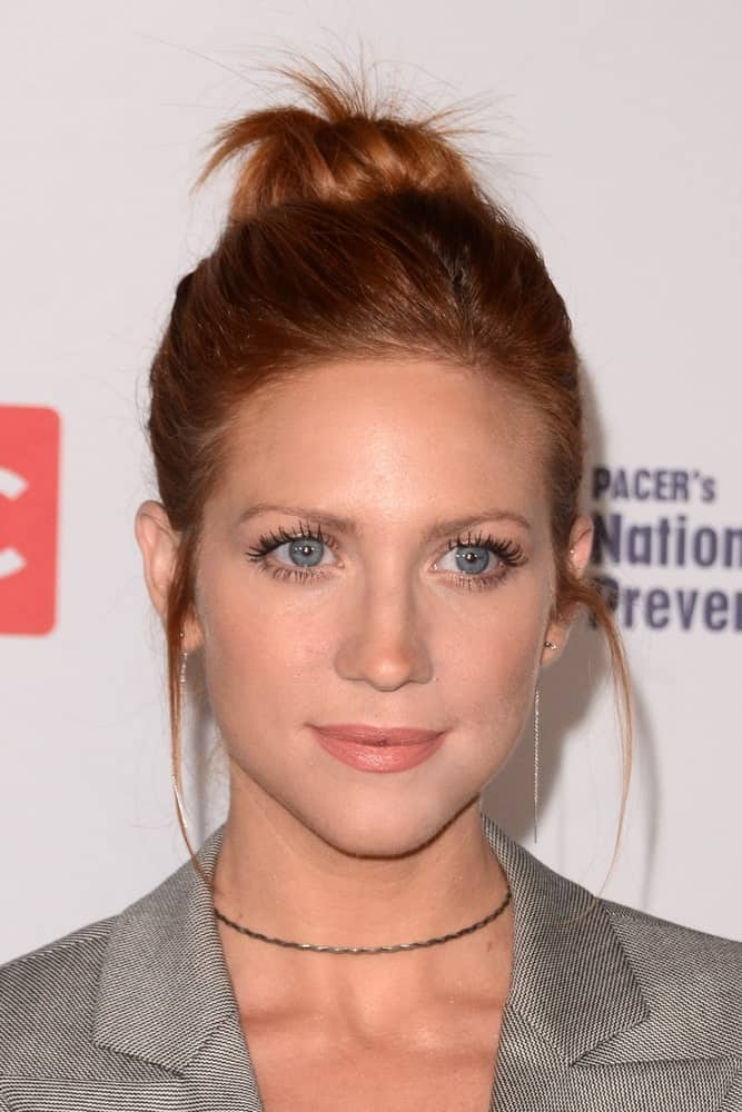 Brittany Snow was at the TLC's Give A Little Awards at the NeueHouse Hollywood on September 27, 2017 in Los Angeles, CA. She wore a gray smart casual outfit to go with her dark reddish high bun hairstyle.