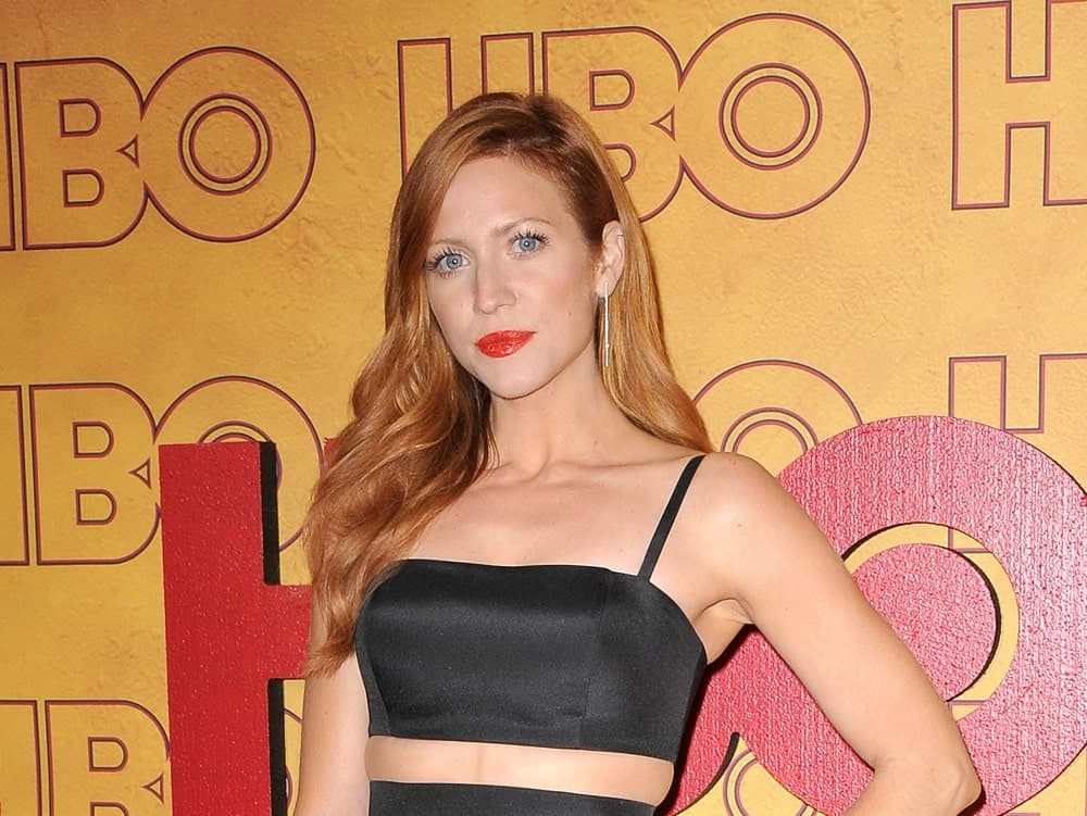 Brittany Snow was at the 2017 HBO's Post Emmy Awards Reception held at the Pacific Design Center in West Hollywood on September 17, 2017. She paired her stunning black dress with a long and side-swept tousled and wavy reddish side-swept hairstyle.