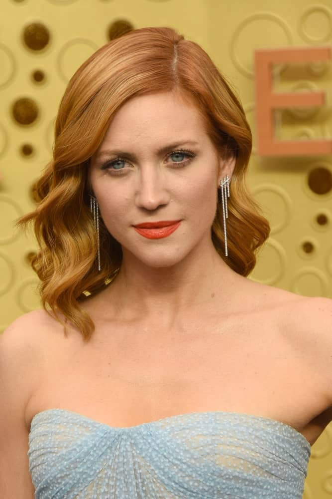 Brittany Snow was at the Primetime Emmy Awards at the Microsoft Theater on September 22, 2019 in Los Angeles, CA. She was elegant in a strapless gown that she paired with her shoulder-length layered reddish brown hairstyle with vintage curls.