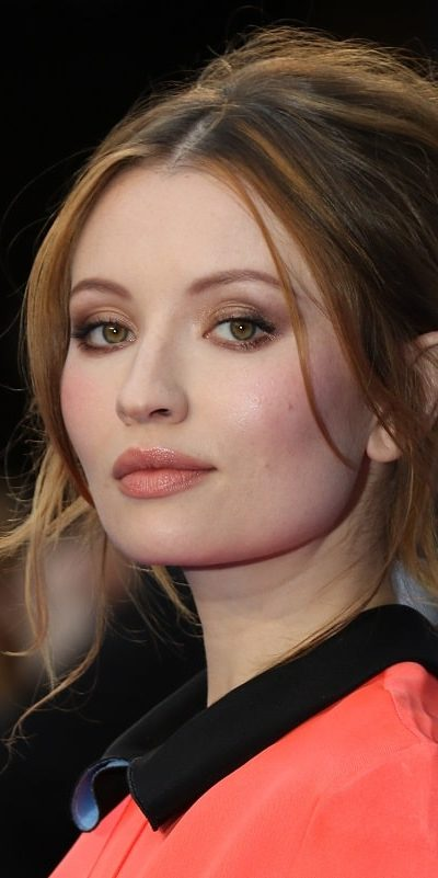Emily Browning attended the Legend UK film premiere on September 3, 2015 in London. She wore an elegant dress to pair with her messy brunette bun hairstyle that has long side-bangs and tendrils.