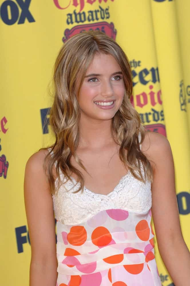 Emma Roberts was at the 2005 Teen Choice Awards at the Universal Amphiteatre, Hollywood on August 14, 2005. She wore a lovely patterned dress with her long and wavy brunette hairstyle that is slightly tousled.