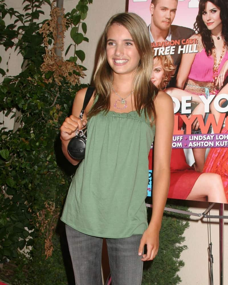 Emma Roberts was at the Teen People Party The Cabana Club in Los Angeles, CA on August 13, 2005. She wore a casual outfit with her long and tousled straight brunette hairstyle with layers.