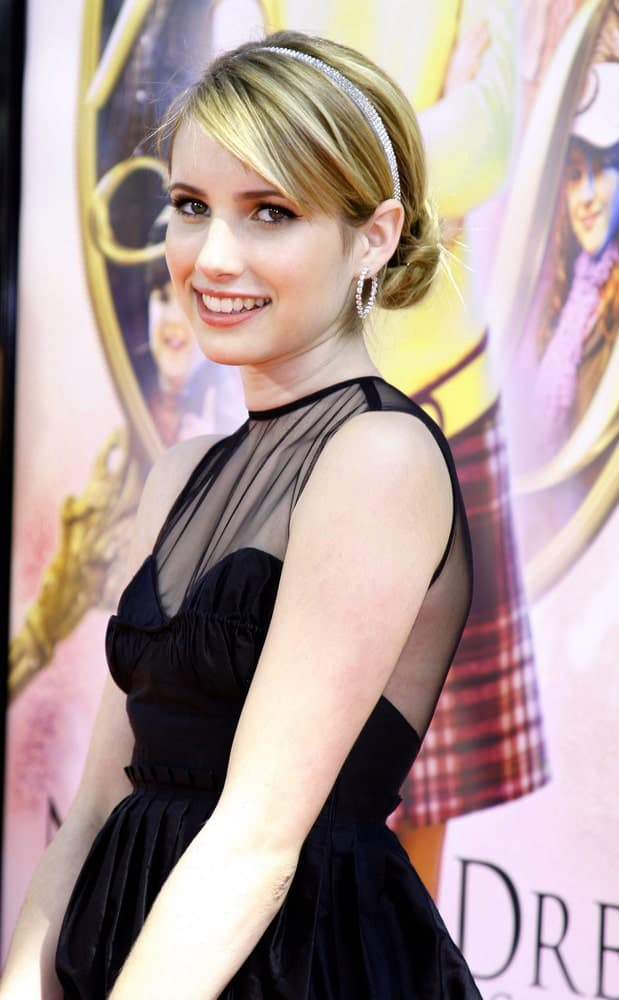 Emma Roberts was at the World premiere of 'Nancy Drew' held at the Grauman's Chinese Theater in Hollywood on June 9, 2007. She was charming in a black dress and highlighted blonde low bun hairstyle with side-swept bangs.