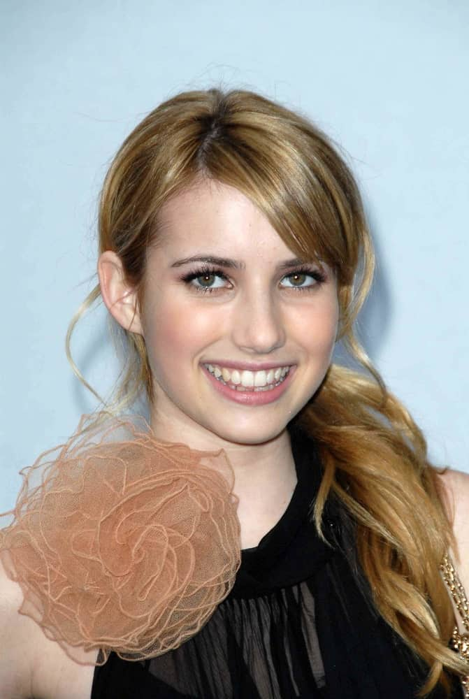 Emma Roberts attended the 2007/2008 Chanel Cruise Show Presented by Karl Lagerfeld at Hangar 8, Santa Monica, CA on May 18, 2007. She wore a lovely black dress with her low ponytail brunette hairstyle with long side-swept bangs.