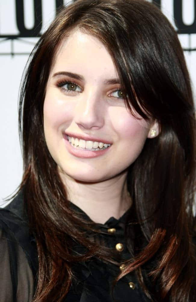 Emma Roberts attended the world premiere of 'Kit Kittredge: An American Girl' at the Grove in Los Angeles, California on June 14, 2008. She wore a black dress with her long dark hairstyle that has layers and long side-swept bangs.
