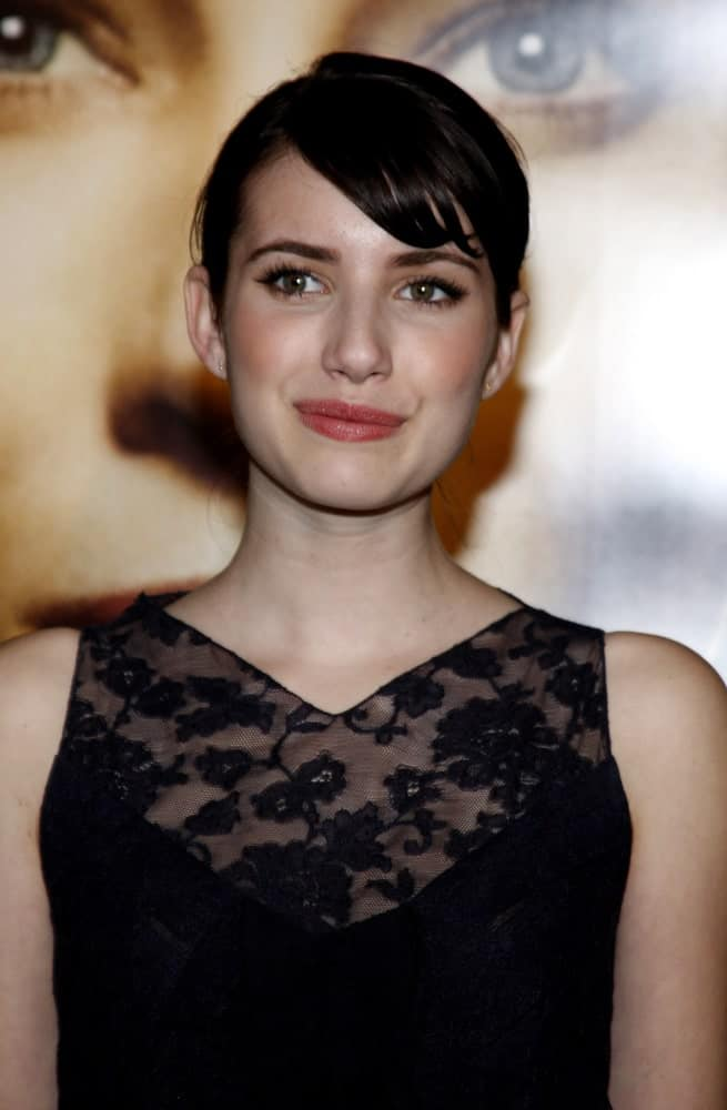 Emma Roberts was at the Los Angeles premiere of 'The Curious Case of Benjamin Button' held at the Mann Village Theater in Westwood on December 8, 2008. She wore a lovely black dress with her raven ponytail hairstyle with loose side-swept bangs.