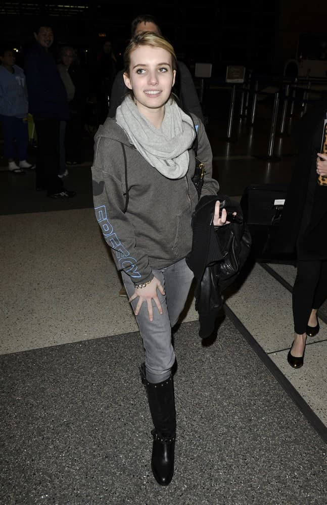 Actress Emma Roberts was seen at LAX (Los Angeles Airport) on February 9, 2010 in Los Angeles, California. She was seen wearing a casual outfit with her neat bun hairstyle with side-swept bangs.