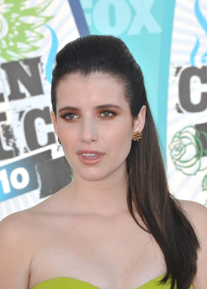 On August 8, 2010, Emma Roberts was at the 2010 Teen Choice Awards at the Gibson Amphitheatre, Universal Studios, Hollywood. She wore a strapless dress that she topped with a raven slicked back straight hairstyle.