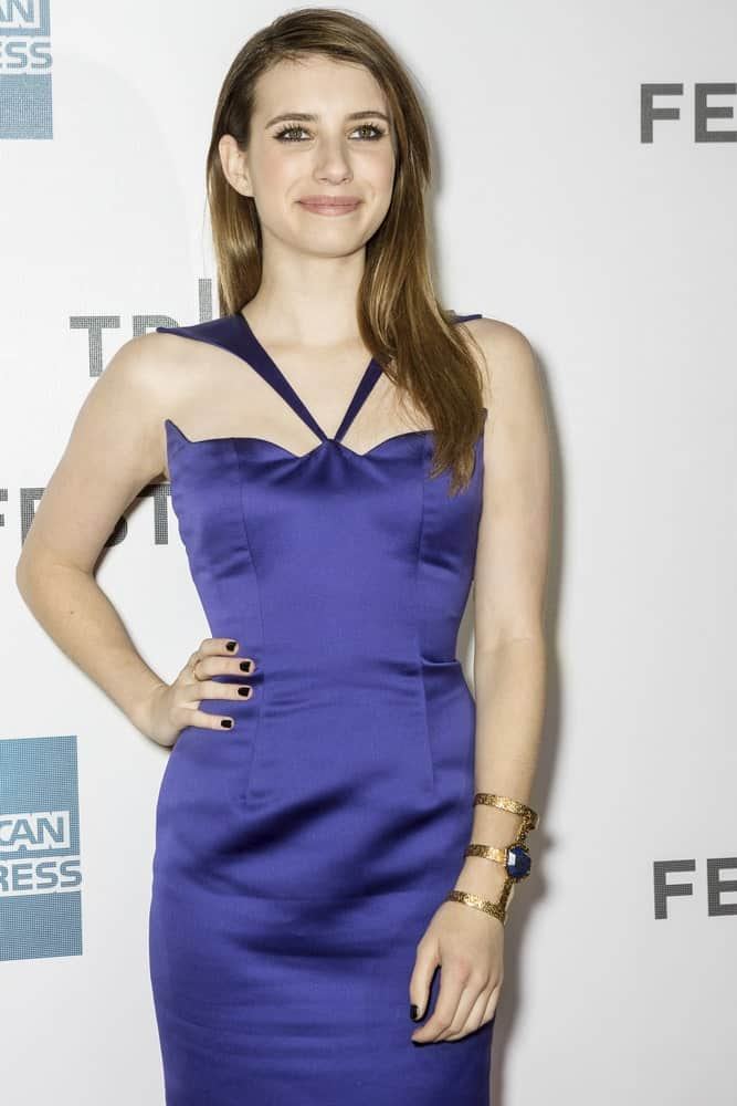 Emma Roberts attended the world premiere of 'Adult World' during the 2013 Tribeca Film Festival on April 18, 2013 in New York. She came wearing a blue dress with her dark and straight brunette layers.