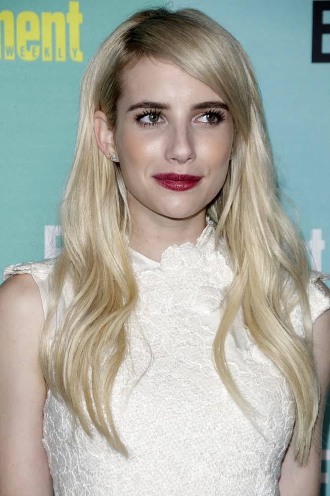 Emma Roberts attended the Entertainment Weekly's Annual Comic-Con Party at the FLOAT at The Hard Rock Hotel on July 11, 2015 in San Diego, CA. She paired her charming white dress with a long and tousled loose blonde hairstyle with side-swept bangs.