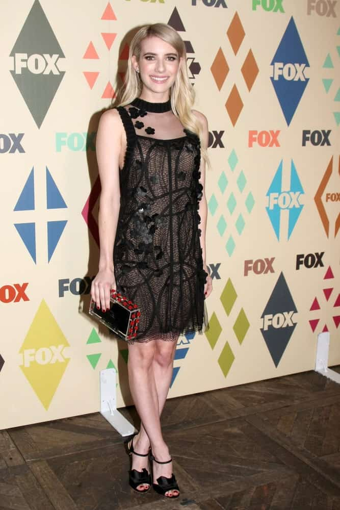 Emma Roberts attended the FOX Summer TCA All-Star Party 2015 at the Soho House on August 6, 2015 in West Hollywood, CA. She was seen wearing a black dress with her long and loose tousled blonde hairstyle tucked behind her ears.
