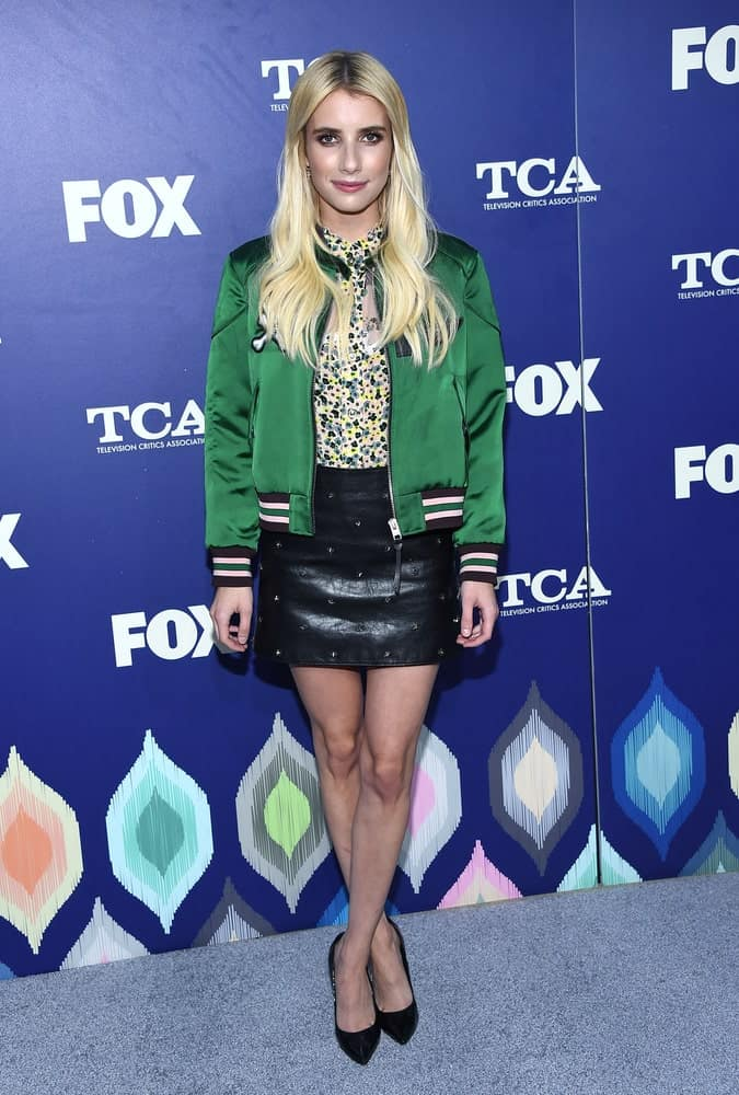 Emma Roberts was at the FOX Summer TCA Party 2016 on August 08, 2016 in West Hollywood, CA. SHe wore a casual ensemble outfit with her long and layered blonde hairstyle that has highlights.