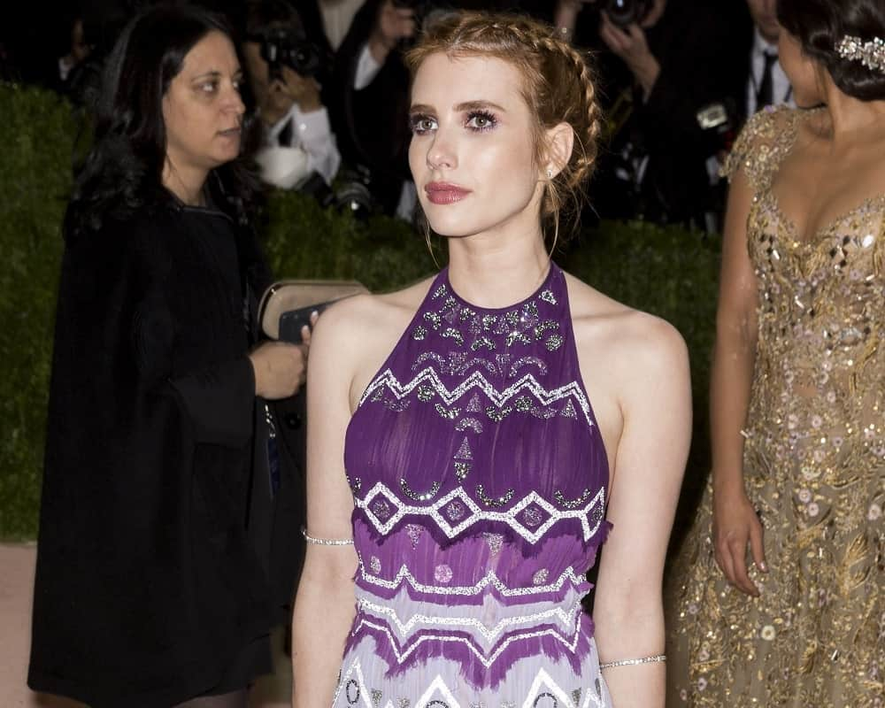 On May 2, 2016, Emma Roberts attended the Manus x Machina Fashion in an Age of Technology Costume Institute Gala at the Metropolitan Museum of Art in New York. She paired her patterned purple sundress with a brunette upstyle incorporated with braids.