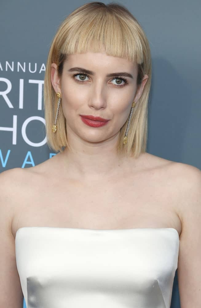 Emma Roberts was at the 23rd Annual Critics' Choice Awards held at the Barker Hangar in Santa Monica on January 11, 2018. She paired her pearly white strapless dress with a chin-length straight blonde hairstyle with short blunt bangs.