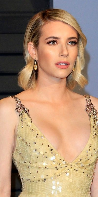 Emma Roberts was at the 24th Vanity Fair Oscar After-Party at the Wallis Annenberg Center for the Performing Arts on March 4, 2018 in Beverly Hills, CA. She was stunning in a golden dress that she topped with a shoulder-length tousled sandy-blonde hairstyle with waves and side-swept bangs.