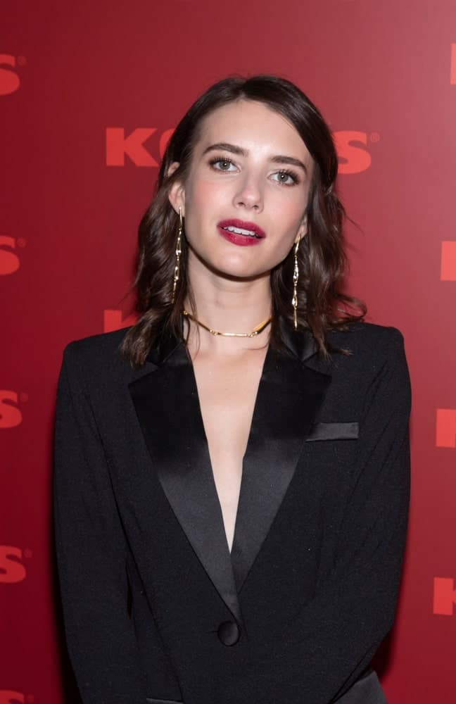 """On November 6, 2019, Emma Roberts attended the Kohl's launch event for the """"New Gifts at Every Turn"""" holiday pop-up at 632 Broadway, New York City. She was charming in a smart casual outfit with her shoulder-length tousled dark hairstyle with layers."""