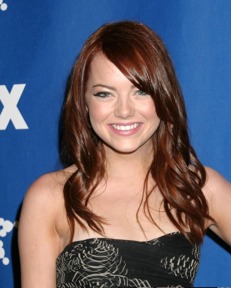 Emma Stone wore a strapless black dress with loose and tousled wavy red hairstyle that has long side-swept bangs at the Fox Television Critics Association Press Tour Party in Pasadena CA on January 20, 2007.