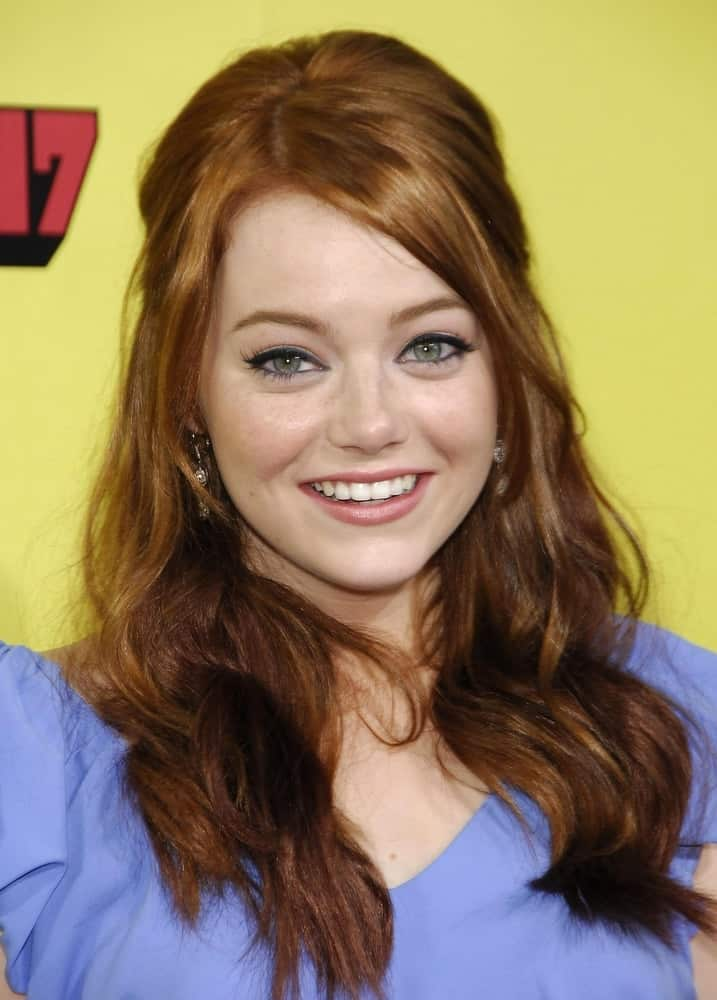 Emma Stone attended the Premiere of SUPERBAD held at the Grauman's Chinese Theatre in Los Angeles, CA on August 13, 2007. She wore a simple blue outfit to go with her medium-length layered half up hairstyle.