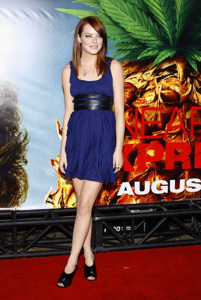 Emma Stone was quite lovely in her blue short dress and medium-lenth straight red hairstyle with side-swept bangs at the World premiere of 'Pineapple Express' held at the Mann Village Theater in Westwood on July 31, 2008.