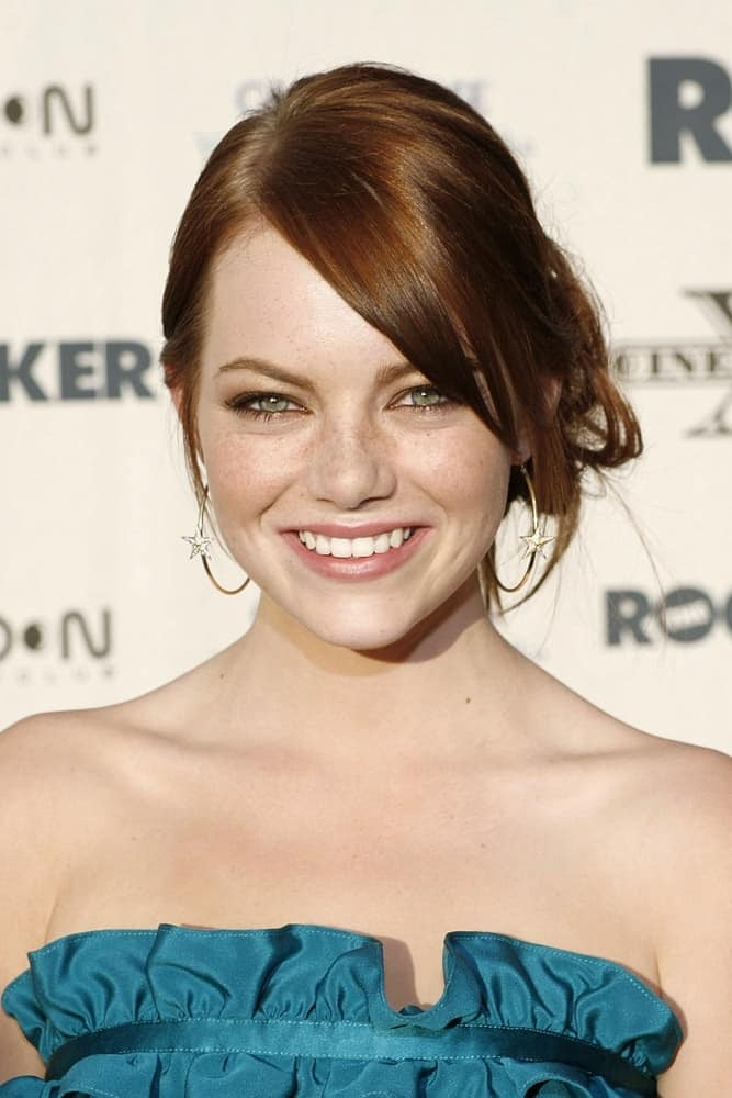 A young Emma Stone attended THE ROCKER Opening Night Premiere of CineVegas 2008 held at the Palms Casino Resort in Las Vegas, NV on June 12, 2008. She wore a blue dress to pair with her loose low bun hairstyle with long side-swept bangs.