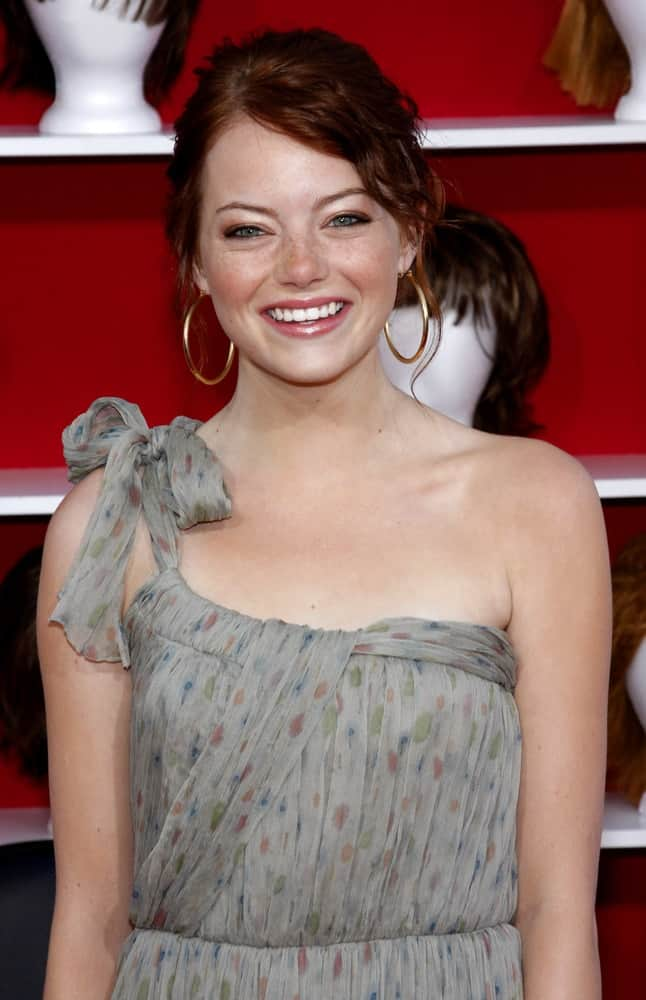 Emma Stone attended the World premiere of 'You Don't Mess With The Zohan' held at the Grauman's Chinese Theater in Hollywood on May 28, 2008. Her simple gray dress went quite well with her messy bun hairstyle that has tendrils and wavy tendrils.