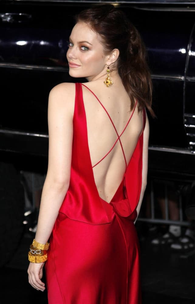 Emma Stone wore a lovely red dress with her messy dark ponytail at the Los Angeles premiere of 'Zombieland' held at the Graman's Chinese Theater in Los Angeles on September 23, 2009.