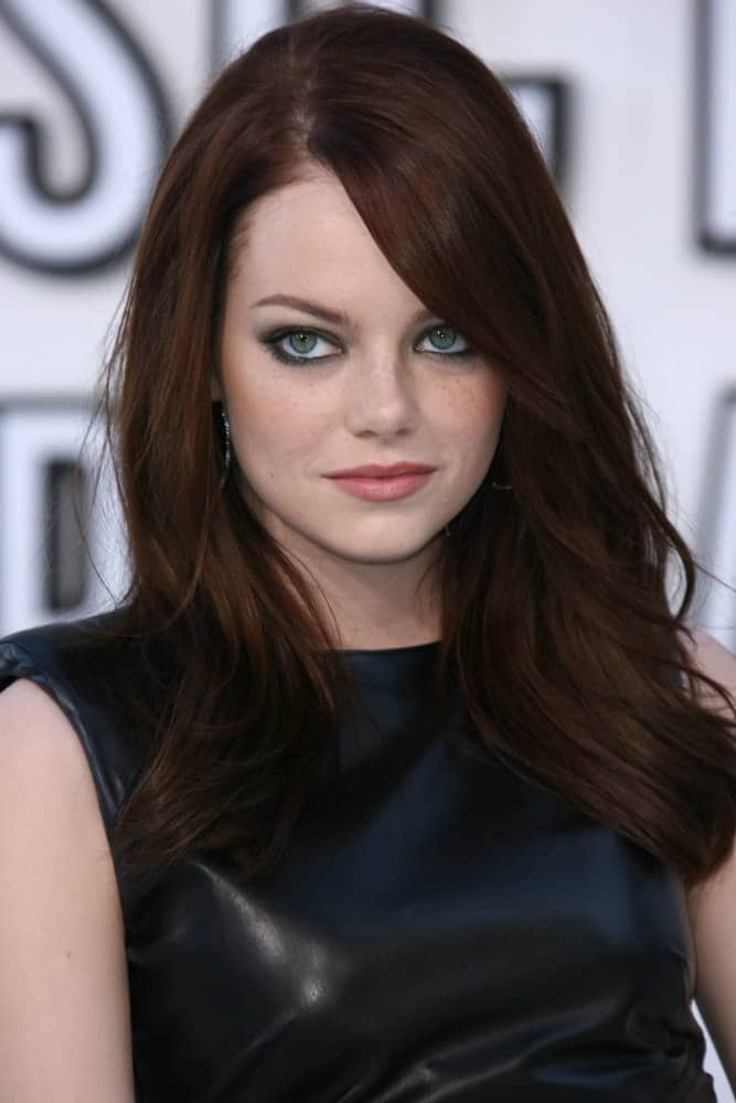 On August 12, 2010, Emma Stone's mesmerizing eyes were emphasized by her dark straight hair with long side-swept bangs at the 2010 MTV Video Music Awards, Nokia Theatre L.A. LIVE in Los Angeles, CA.