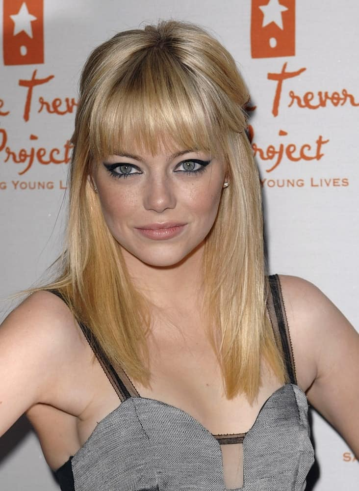 Emma Stone's smokey eyes totally complemented her half-up straight blond hairstyle with blunt bangs at the Trevor LIVE Annual Benefiting for The Trevor Project, The Hollywood Palladium in Los Angeles, CA on December 5, 2010.
