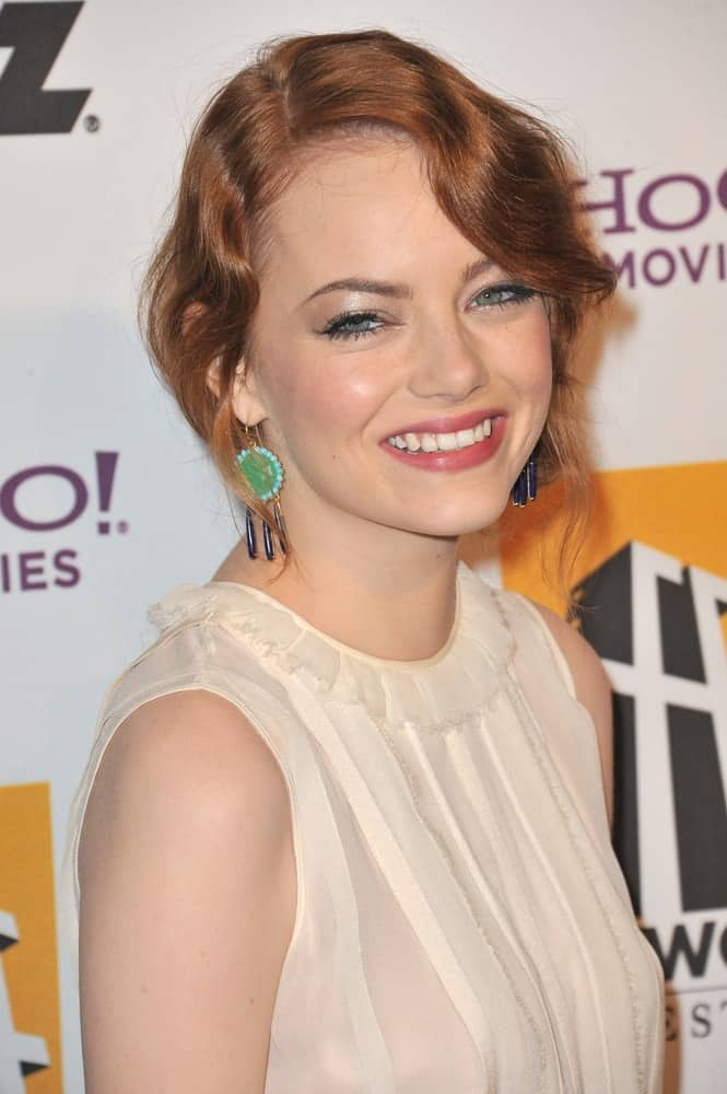 Emma Stone flashed her iconic beautiful smile with her wavy and loose red hairstyle that has a vintage look at the 15th Annual Hollywood Film Awards Gala at the Beverly Hilton Hotel on October 24, 2011 in Beverly Hills, CA.