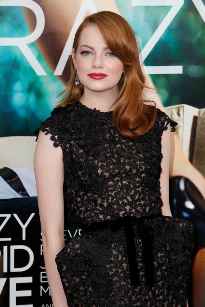 Emma Stone's embroidered black floral dress totally paired well with her bold red lips and layered side-swept red hairstyle at the world movie premiere of