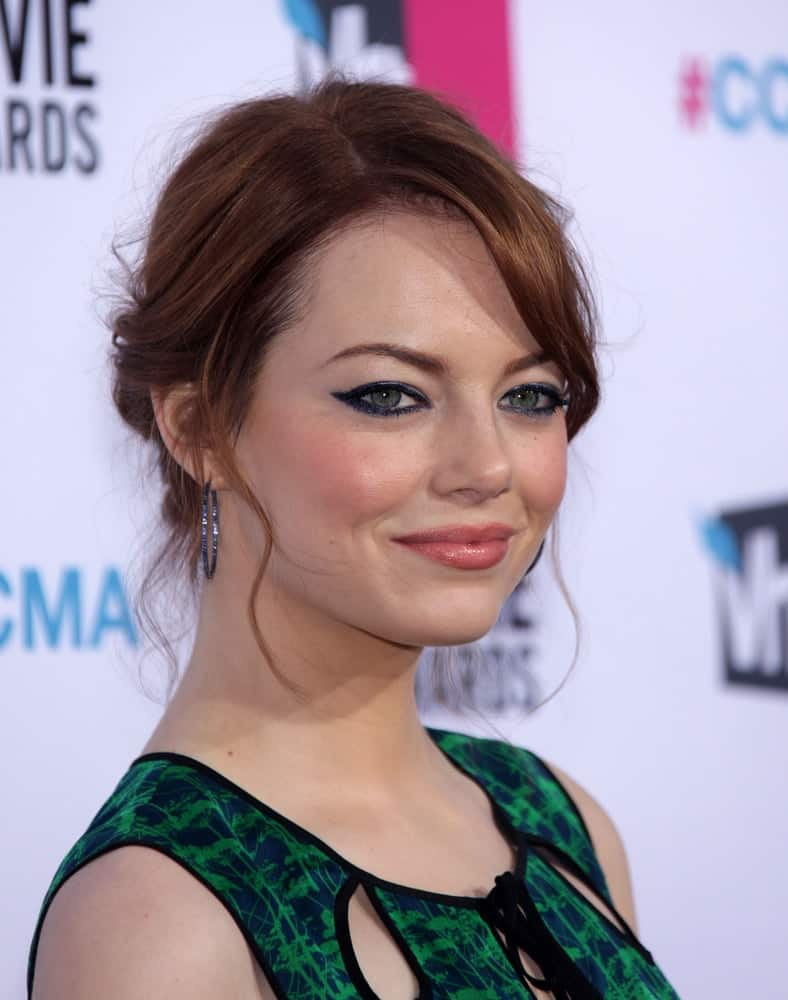 Emma Stone attended the Critic's Choice Movie Awards 2012 on January 12, 2012 in Hollywood, CA. She came in a simple green dress that emphasized her elegance along with her messy bun hairstyle with tendrils.