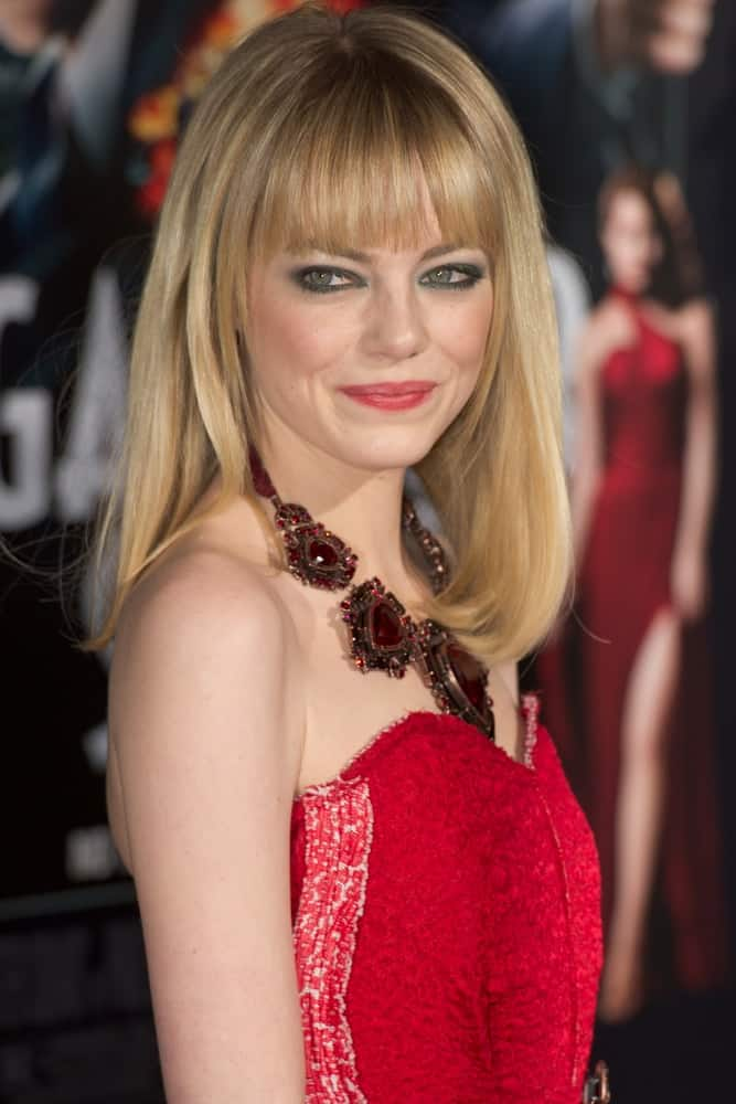 Emma Stone's lovely smokey eyes were on full display with her red dress and straight blond hairstyle with blunt bangs when she arrived at the premiere of Gangster Squad at Grauman's Chinese Theatre in Los Angeles, CA on January 7, 2013.