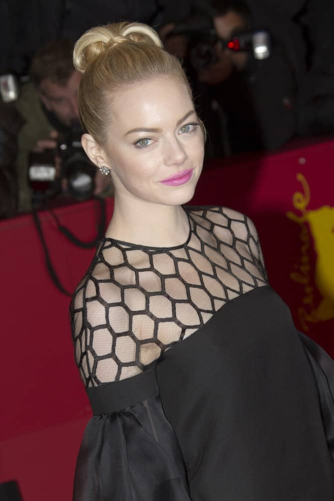 Emma Stone attended 'The Croods' Premiere during the 63rd Berlinale Film Festival at Berlinale Palast on February 15, 2013 in Berlin, Germany. She came in a vintage black dress that went quite well with her blond, and slick top knot bun hairstyle.