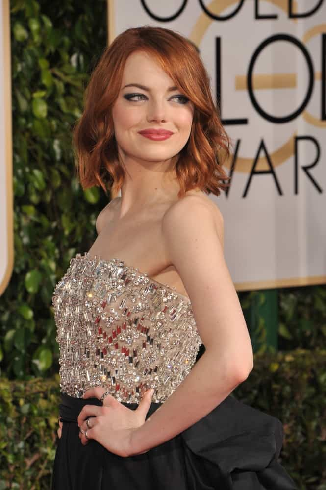 On January 11, 2015, Emma Stone flaunted her lovely red bob hairstyle incorporated with a tousle, some waves and highlights at the 72nd Annual Golden Globe Awards at the Beverly Hilton Hotel, Beverly Hills.
