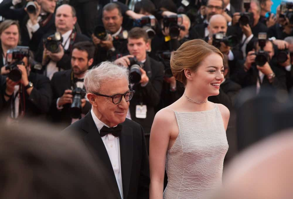 Woody Allen and Emma Stone attended the 'Irrational Man' premiere during the 68th annual Cannes Film Festival on May 15, 2015 in Cannes, France. Stone was a picture of elegance in her simple white dress and upstyle hair that has highlights.