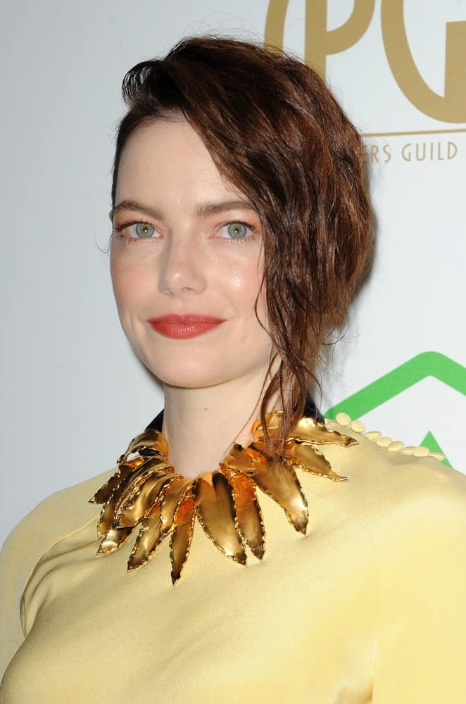 Emma Stone was quite fashionable and stylish with her gorgeous yellow dress, accessories and tousled side-swept hairstyle with a half up look at the 30th Annual Producers Guild Awards held at the Beverly Hilton Hotel in Beverly Hills on January 19, 2019.