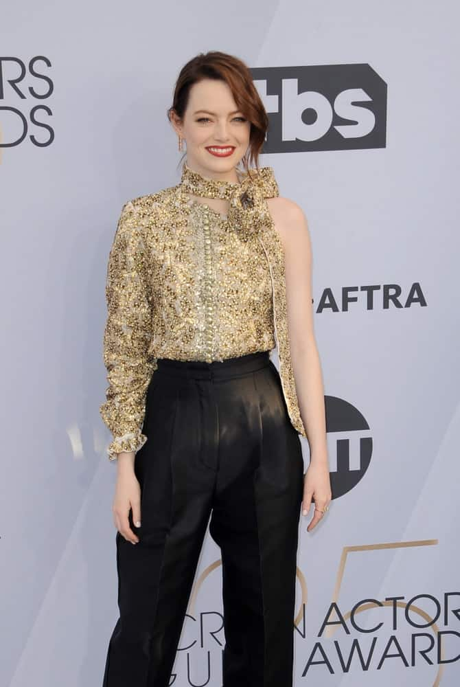 Emma Stone sported a stylish smart casual ensemble outfit with her messy bun hairstyle that has long side-swept bangs at the 25th Annual Screen Actors Guild Awards held at the Shrine Auditorium in Los Angeles on January 27, 2019.