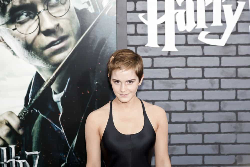 Actress Emma Watson attended the premiere of 'Harry Potter and the Deathly Hallows: Part 1' at Alice Tully Hall on November 15, 2010 in New York City. She was wearing a silky black dress that she paired with her short pixie hairstyle that has short bangs.