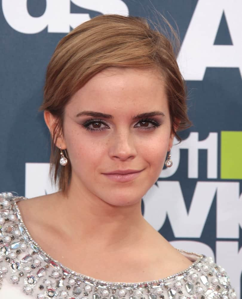 Actress Emma Watson was at the MTV Movie Awards 2011 on June 05, 2011 in Hollywood, CA. She caught everyone's attention with her jeweled outfit and stylish tousled side-parted pixie hairstyle.